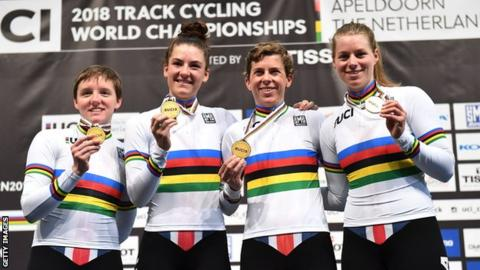 USA women's team pursuit squad (from left to right) Kelly Catlin, Chloe Dygert Owen, Kimberly Geist and Jennifer Valente hold up their gold medals after victory at the 2018 World Championships