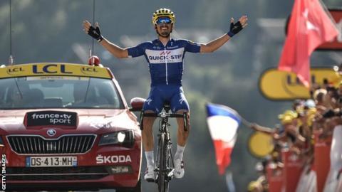 Julian Alaphilippe celebrates winning stage 10