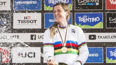 Rachel Atherton sprays champagne after being crowned world champion in 2016