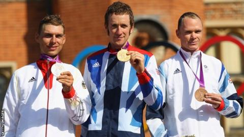 Tony Martin, Bradley Wiggins and Chris Froome with their Olympic time trial medals on the podium at London 2012