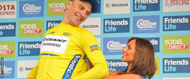 Marcel Kittel is awarded the race leader's jersey after winning stage one in Liverpool