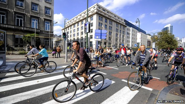 Belgians riding bikes on car-free-Sunday