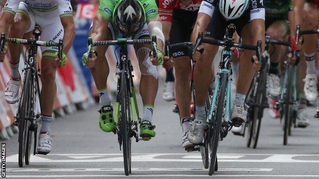 Peter Sagan (green) and Matte Trentin cross the line