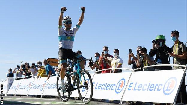 Astana's Alexey Lutsenko raises his arms in celebration after winning stage six of the 2020 Tour de France