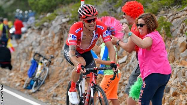 Nicolas Roche is cheered on by some colourful fans during last year's Vuelta a Espana