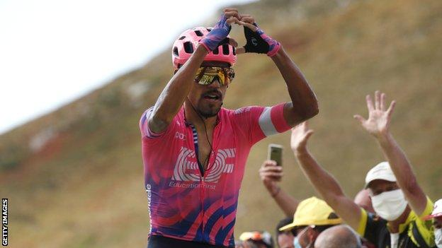 Daniel Martinez holds his hands up in celebration after winning stage 13 of the 2020 Tour de France