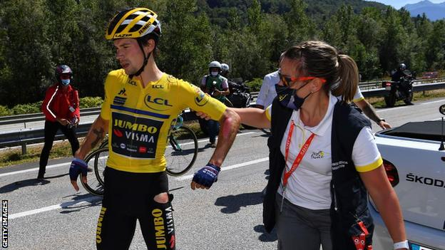 Primoz Roglic with a medic after his crash on Saturday