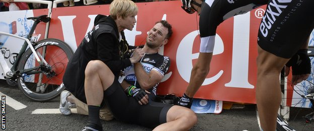Mark Cavendish injured receives medical assistance after a fall near the finish line at the first stage of the Tour de France in 2014