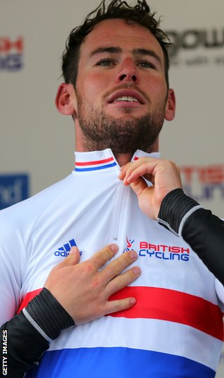 Mark Cavendish zips up the British champion's jersey he won in the National Road Race in Glasgow on Saturday