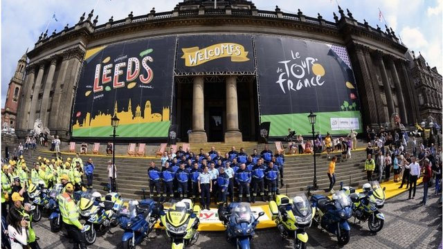 French Republican Guards, working on Tour de France security, pose for a family picture in front of the city hall of Leeds, northern England, on July 4, 2014