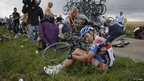 Garmin rider Tom Danielson surveys his injuries after crashing on stage six