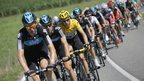 Team Sky lead the peloton with Bradley Wiggins in yellow