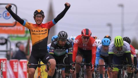 Spain's Ivan Garcia Cortina (left) raises his arms after holding off the pack to win stage three of Paris-Nice in a bunch sprint finish