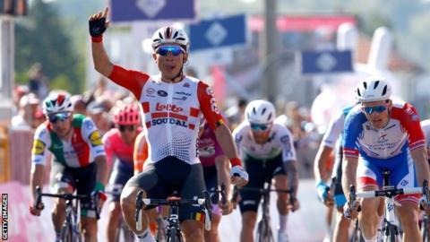 Caleb Ewan celebrates after winning stage