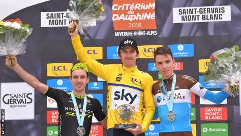 Geraint Thomas (c) celebrates victory over Adam Yates (R) amp; Romain Bardet (L)