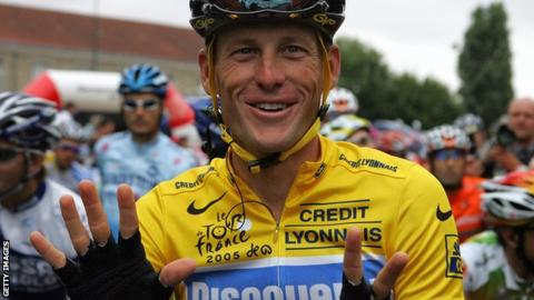 Lance Armstrong holds up seven fingers while wearing the yellow jersey in 2005 to signify the seven Tour de France titles he was later stripped of