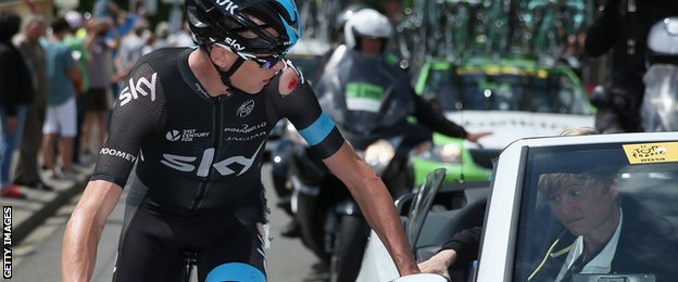 Chris Froome receives treatment after falling off his bike during the 2014 Tour de France