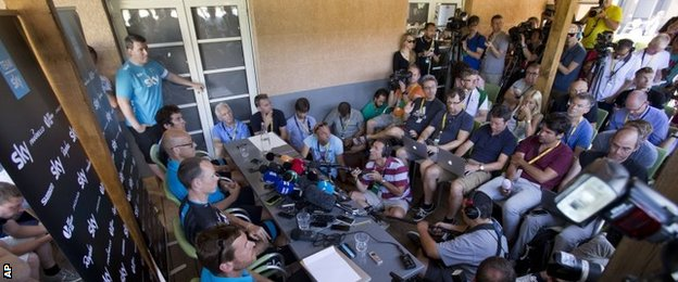 Chris Froome faces the press