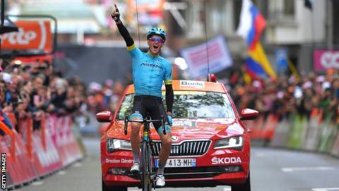 Danish cyclist Jakob Fugslang points to the sky in celebration after winning the 2019 Liege-Bastogne-Liege