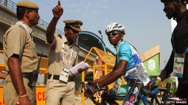 Cyclists Sesay Moses Lansana and Seisay Augustine of Sierra Leone (right) talk to security officials at the athletes village ahead of the 2010 Commonwealth Games in Delhi