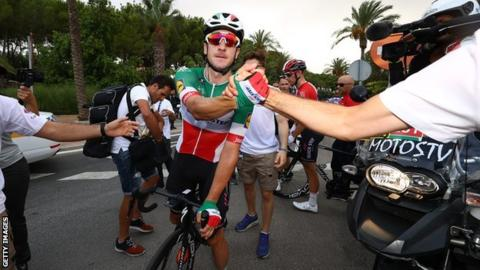 Elia Viviani celebrates winning stage three of the Vuelta a Espana