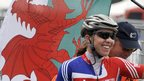 Nicole Cooke flies the Welsh flag after winning the 2008 women's world road racing title in Varese, Italy