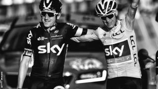 Geraint Thomas (left) crosses the Tour de France finish line with winner and Team Sky leader Chris Froome