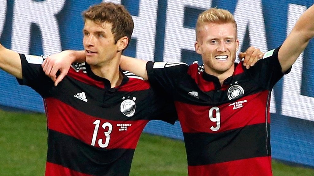 Germany's Thomas Muller and Andre Schurrle celebrate against Brazil