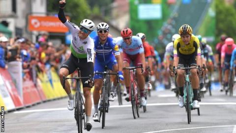Edvald Boasson Hagen (left) wins the opening stage, ahead of Team Deceuninck-QuickStep's Phillipe Gilbert (centre) and Wout van Aert of Team Jumbo-Visma