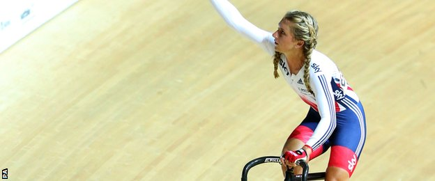Laura Trott celebrates after winning the omnium