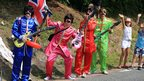 Fans dressed as The Beatles enjoy the atmosphere during stage fourteen