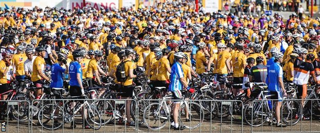 Massed ranks of yellow-clad cyclists gather in readiness to ride the route of this years' first stage in Utrecht