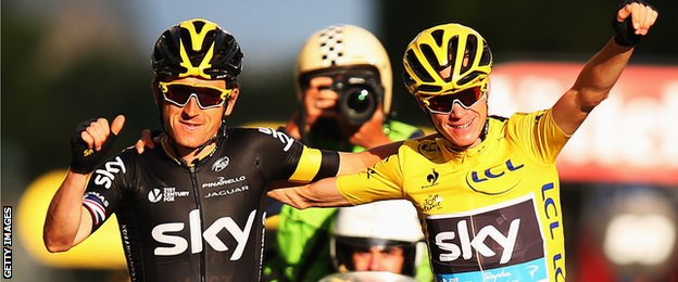 Chris Froome and Geraint Thomas celebrates as Froome nears the end of the final stage of the 2015 Tour de France