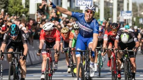 Marcel Kittel (centre) wins from Elia Viviani (left) and Mark Cavendish (right)
