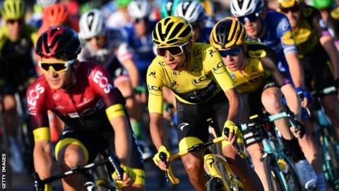 Team Ineos rider Egan Bernal races in Paris wearing the yellow jersey as winner of the 2019 Tour de France