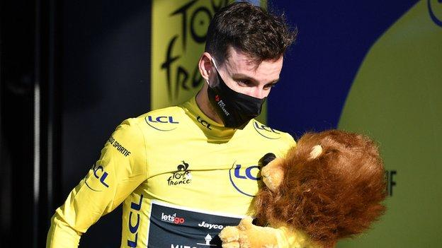 Adam Yates leaves the podium in the yellow jersey after stage five of the 2020 Tour de France