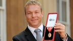 Chris Hoy with the knighthood medal he received at Buckingham Palace