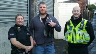 Rob Davies (centre) who found the shoes with PC Alex Reed and PC Stephen Westlake