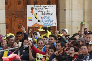 Fans hold a sign that reads You made millions of hearts shake with happiness. What an example, Egan! during a tribute to Colombian cyclist Egan Bernal, winner of the Tour de France 2019, at his hometown, Zipaquira, in Cundinamarca, Colombia