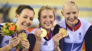 Dani King, Jo Roswell and Laura Trott celebrate with their gold medals