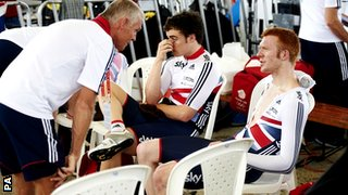 British Cycling coach Shane Sutton (left) talks to Ed Clancy