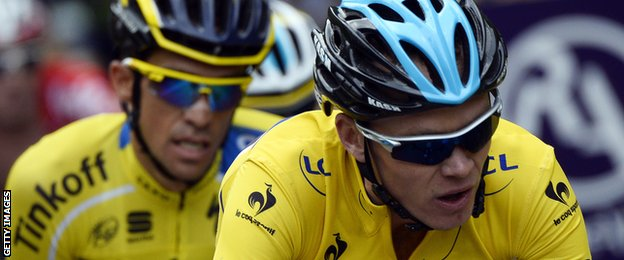 British cyclist Christopher Froome and Spanish cyclist Alberto Contador compete during the seventh stage of the 66th edition of the Dauphine Criterium cycling race.