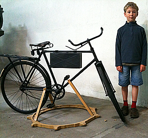 Johnny Jnr looks over a WW1 dispatch messenger bike
